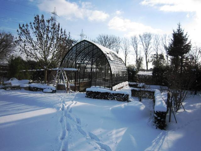 authentic freestanding conservatory in the snow during winter DBG Classics